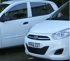 White Hyundai Courtesy Cars